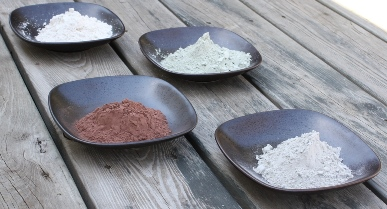 A group of white, red, green and bentonite clay