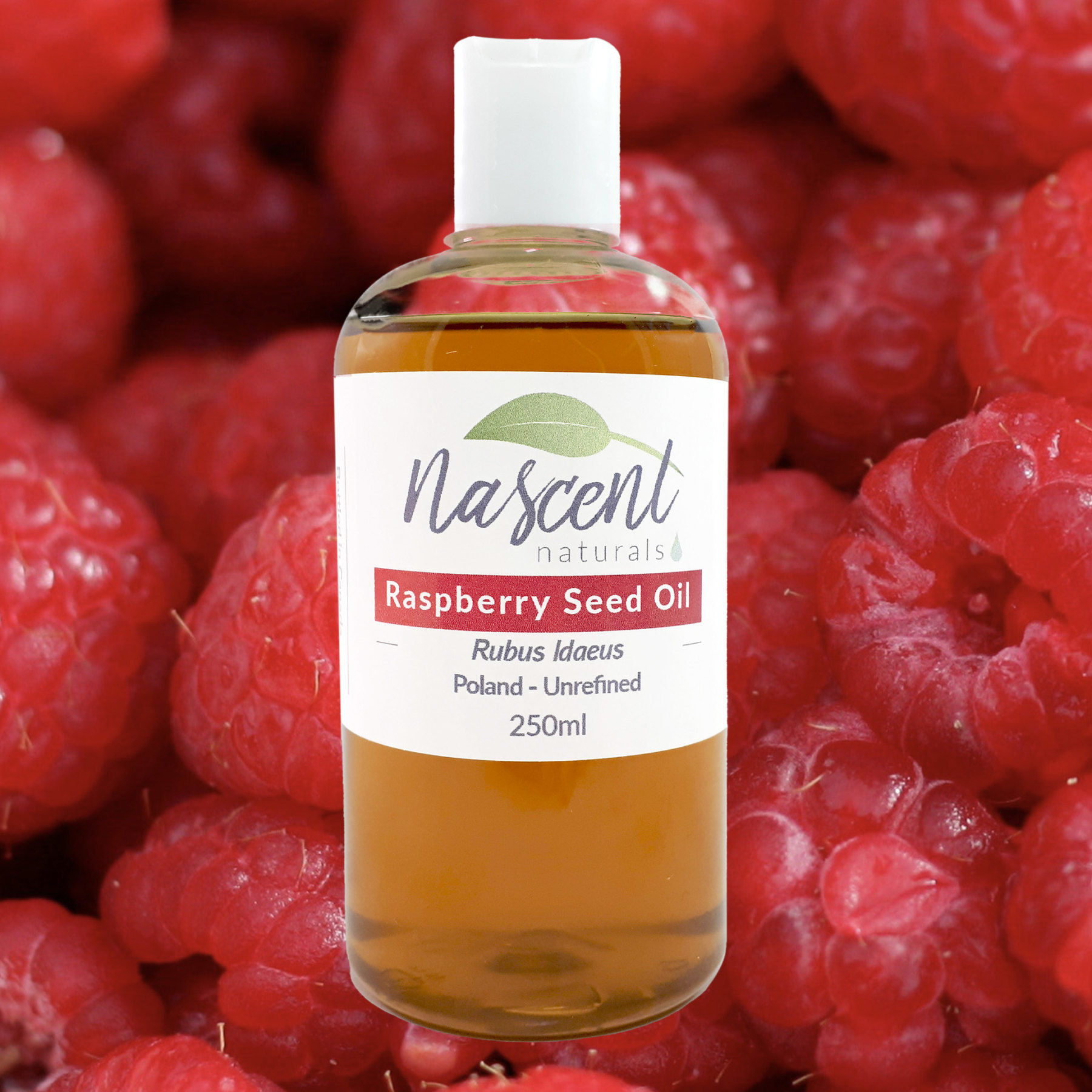A bottle of Raspberry seed oil in front of a background of raspberries