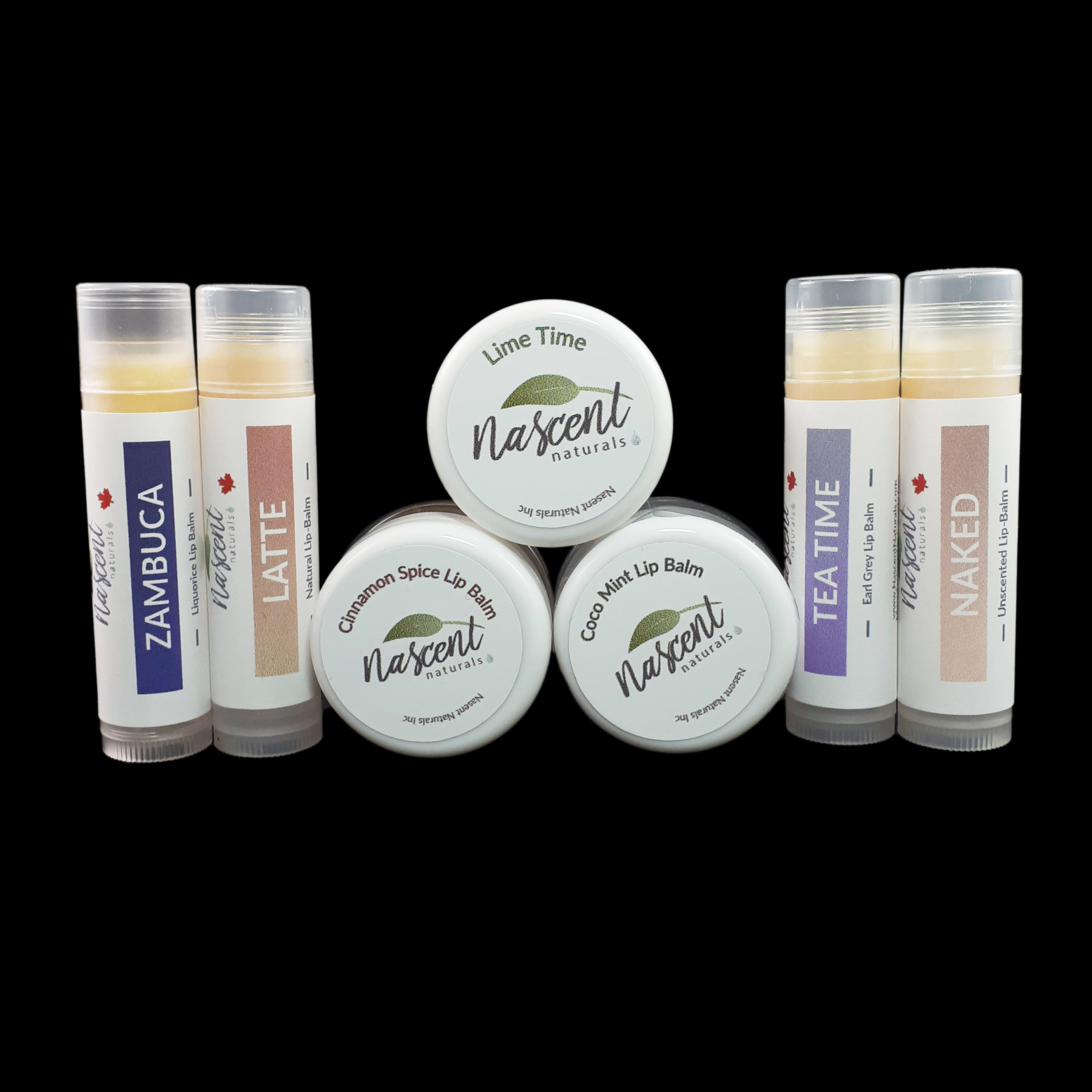 A pyramid of three lip balm jars with two tube lip balms on either side of the pyramid