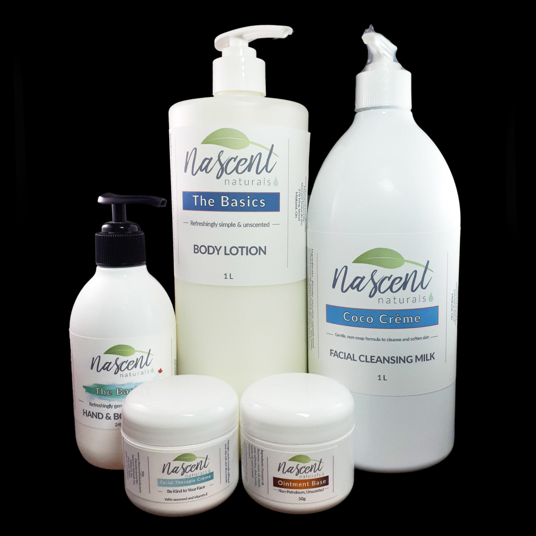A collection of unscented Nascent Naturals products in front of a black background. The products are: Hand and Body Wash, The Basics Lotion, Coco Creme Cleanser, Facial Therapy Creme, and Ointment Base